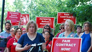 Nurses' union president Laurie Aunchman, right, and negotiator Julie MacMillan speaking to reporters