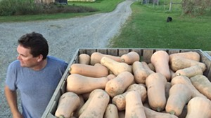 Eric Rozendaal with his butternut squash at Rockville Market Farm in Starksboro