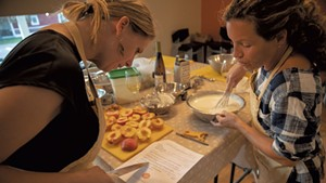 Students preparing peaches for dessert at a Richmond Community Kitchen class