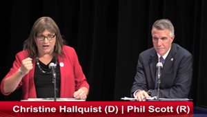 Christine Hallquist and Gov. Phil Scott at Wednesday's debate in Rutland