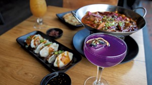 House cocktail with butterfly pea flower, Mongolian lamb with hot chile, scallion pancake and Sichuan spicy dumplings at Mandarin in Winooski