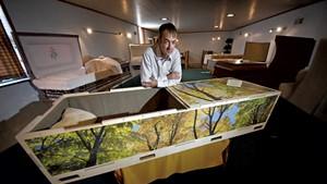 Matt Kasvinsky with one of his handcrafted caskets