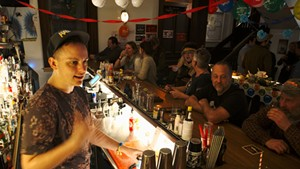 Owen Daniel-McCarter schmoozing with patrons at Babes Bar in Bethel