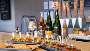 Heritage and ice cider flights with a curried-vegetable hand pie at Eden Specialty Ciders Boutique Taproom & Cheese Bar