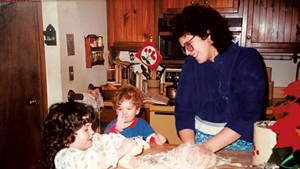 Evan Ross (center) making cookies as a child