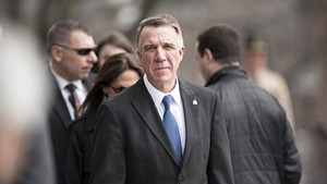 Gov. Phil Scott arrives at the statehouse for the bill-signing ceremony.
