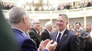 Vermont National Guard Adjutant General Steven Cray greets Gov. Phil Scott at the governor's inauguration.