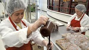 Vietnam natives Hoa Thi Nguyen (left) and Elena Le at Lake Champlain Chocolates