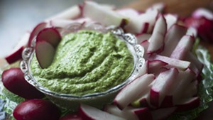 Radish sticks with green-garlic-and-radish-greens pesto: light and crisp for a hot summer's day.