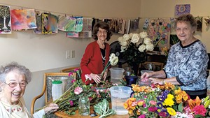 Residents arranging flowers from their garden