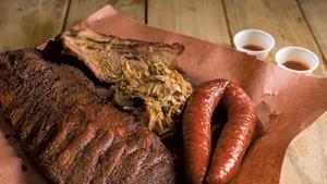 Smorgasbord of smoked meats: ribs, brisket, pulled pork and sausage