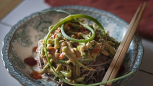 Garlic scapes in peanut sauce over noodles