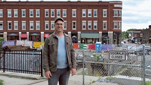 David Hohenschau in front of construction in downtown Middlebury