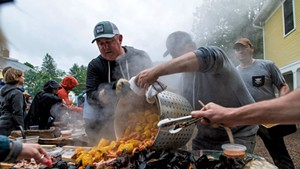 Eric Warnstedt (left) and Will McNeill (center) serving a high-country shrimp boil at 18 Elm