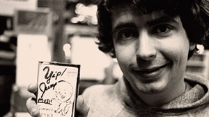 A young Daniel Johnston holding one of his homemade cassettes