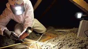Brian Hyde of Energy Co-op of Vermont, sealing gaps in a Colchester attic
