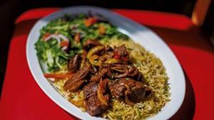 A classic Somali dish of goat and rice at Kismayo Kitchen
