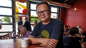 Owner Jake Tran with a pork carnitas omelette at the Firebird Café