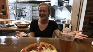 Sara Rooke serves an eggplant parmesan hero at Mimmo's