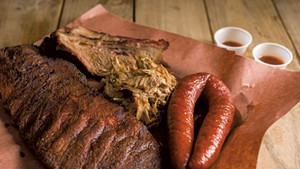 Smorgasbord of smoked meats: ribs, brisket, pulled pork and sausage