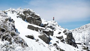 A snowboarder on the ridgeline of Mount Mansfield