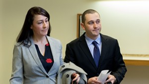 Jason Lawton, right, with his attorney, Rebecca Otey