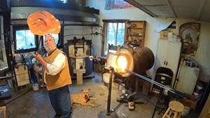 Robert Burch makes a glass bowl