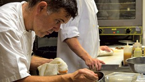 Herve Mahe plating food at Bistro de Margot