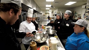 Chef Joey Buttendorf teaching at the Community Kitchen Academy