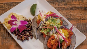 Buffalo cauliflower tacos with turmeric slaw and blue cheese crema, served with brown jasmine rice and Cuban black beans