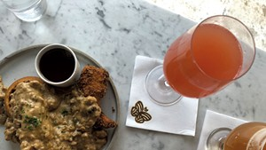Half order of chicken and waffles at Monarch & the Milkweed, with brunch beverages