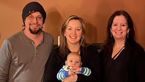 New owners of the Daily Planet, from left; Neil Solis, Rachel Solis (with 3-month-old Lyle) and Nicole Elithorpe.