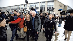 Sen. Bernie Sanders and Jane O'Meara Sanders outside a polling place in Manchester, N.H.