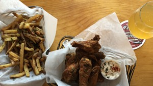 Dry-rubbed chicken wings and fries at St. Paul Street Gastrogrub