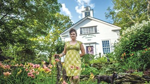 Gardener Jen Kennedy with her dog, Tobias, at home in Underhill