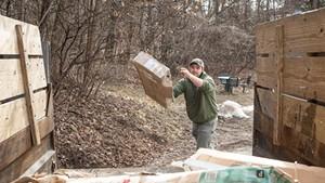 Kyler Leduc loading a truck for Grunts Move Junk in Burlington