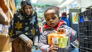 Nuna Ahmed and her grandson Mukhatar Kassim shop earlier this year at the Feeding Chittenden food pantry in Burlington.
