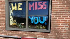 A sign in a window at the Hinesburg Community School