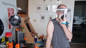 Jake Blend showing off one of his prototype face shields