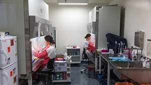Workers running coronavirus tests at the Vermont Health Department lab