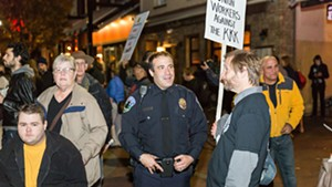 Burlington Police Chief Brandon del Pozo attending a rally at which residents protest KKK fliers