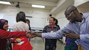 Ali Dieng, right, welcoming Khinaye Lwin, left, to Parent University