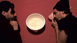 Jacob Tischler and his doppelgänger sharing a moment over a bowl of rising sourdough