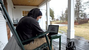 Mitch Hunt using the Wi-Fi outside of the Craftsbury library