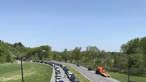 Cars waiting in line to receive food on the Beltline Tuesday in Burlington