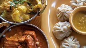 Vegetable korma, chicken momos and chicken tikka masala