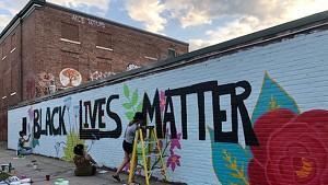 Arts So Wonderful muralists at work in downtown Burlington