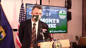 Gov. Phil Scott wearing a mask at Friday's press conference