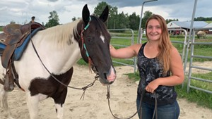Lakenna Loura-Bumps, a trainer at Gonyaw Farm and Koen, a trail horse