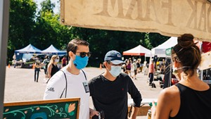 Local Maverick founder Ryan Nakhleh (left) and team member Alex Farrell shopping at the Hudak Farm stand at the Burlington Farmers Market